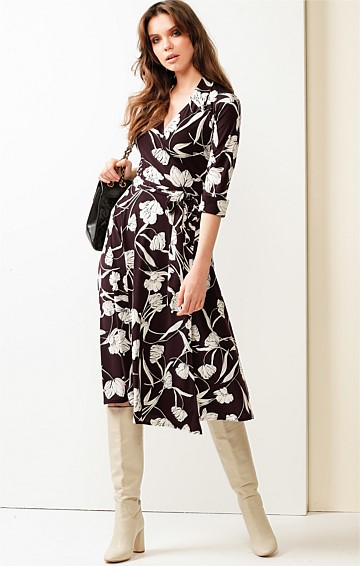 MAURICE 3/4 SLEEVE STRETCH JERSEY V-NECK A-LINE MIDI LENGTH WRAP DRESS IN PLUM IVORY FLORAL PRINT