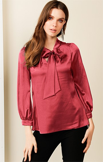HATCHIE BISHOP SLEEVE TIE NECK LOOSE FIT BLOUSE IN ROUGE SATIN