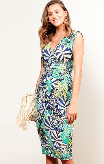 HAVANA NIGHTS FITTED STRETCH JERSEY CAP SLEEVE V-NECK MIDI DRESS IN AQUA NAVY PALM PRINT