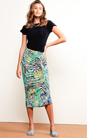 JUNGLE BEAT FITTED STRETCH JERSEY ADJUSTABLE MIDI SKIRT IN AQUA NAVY PALM PRINT