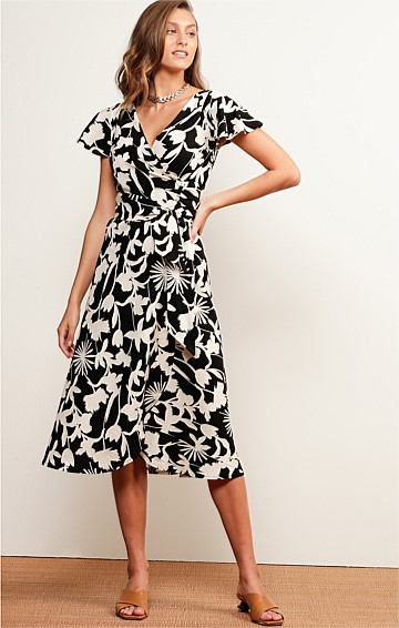 LONG LUNCH LINEN CAP SLEEVE V-NECK A-LINE MIDI WRAP DRESS IN EBONY IVORY FLORAL