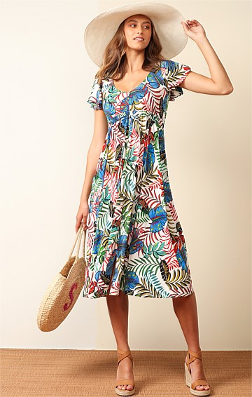 COOCHIEMUDLO STRETCH JERSEY V-NECK LOOSE-FIT MIDI DRESS IN WHITE BOLD BOTANICAL