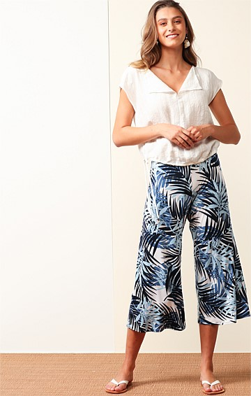 CYLINDER BEACH STRETCH JERSEY LOOSE-FIT WIDE LEG MIDI CULOTTE IN BLUE WHITE PALM PRINT