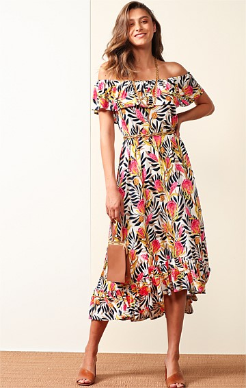 POINT LOOKOUT STRETCH JERSEY OFF THE SHOULDER FRILL A-LINE MIDI DRESS IN PINK WHITE BANKSIA PRINT