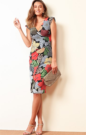COOLANGATTA FAUX WRAP STRETCH JERSEY CAP SLEEVE V-NECK KNEE LENGTH DRESS IN BOLD FLORAL BLACK PRINT