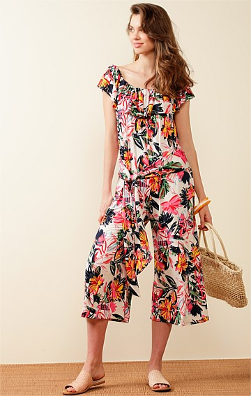 CHEVRON ISLAND STRETCH JERSEY OFF THE SHOULDER FRILL JUMPSUIT IN PINK ABSTRACT FLORAL PRINT