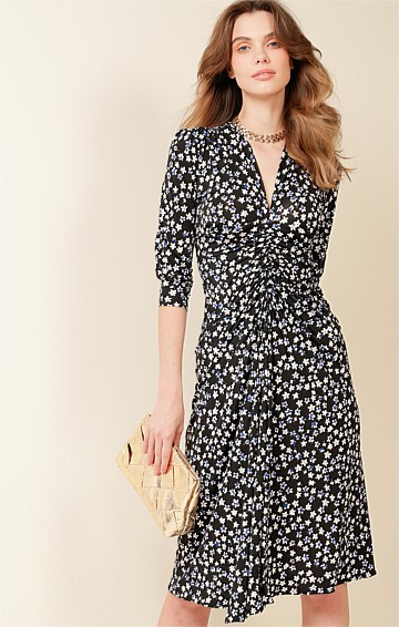SPRING HILL STRETCH JERSEY V-NECK MIDI DRESS IN BLACK WHITE BLUE FLOWER PRINT
