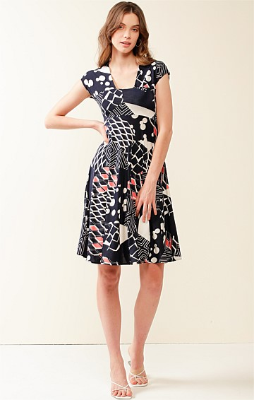 HOWARD WHARVES STRETCH JERSEY CAP SLEEVE A-LINE KNEE LENGTH DRESS IN NAVY WHITE PINK ABSTRACT PRINT